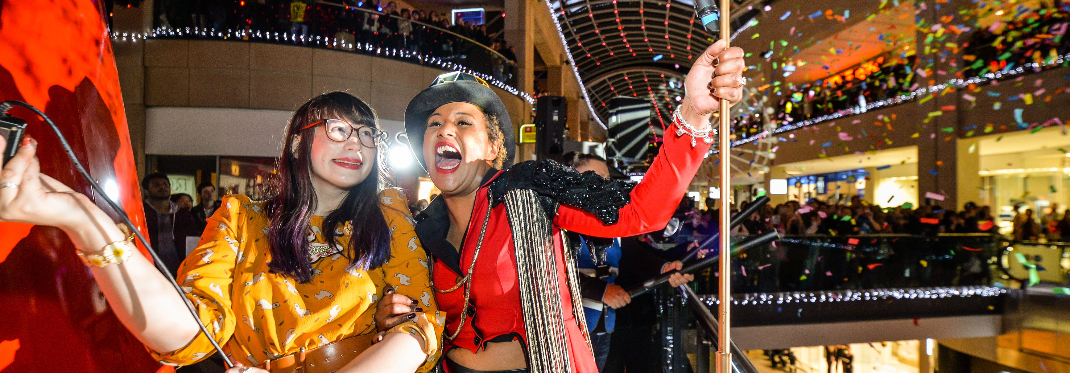Great British Bake Off Finalist Kim-Joy and DJ JoJo switch on the Trinity Leeds Christmas Lights